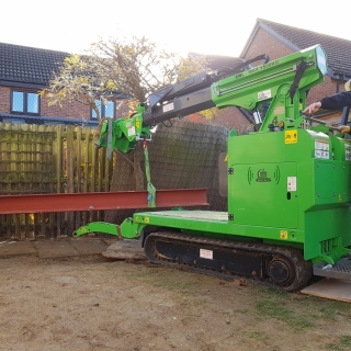 450kg steel I-beam moving and installation with the Hooka lift and carry crawler, alternative to manual handling. Hired from Hook-up Solutions call 07971 174 523 for Southern Hire or 01462 499 642 for Eastern Hire