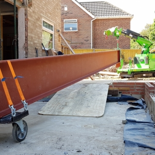 Huge steel I-beam installation the easy way with the Hooka lift and carry crawler image 3. Hired from Hook-up Solutions call 07971 174 523 for Southern Hire or 01462 499 642 for Eastern Hire