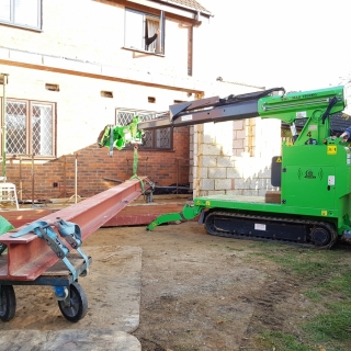 Moving 450kg steel I-beam for installation with the Hooka, precision lift. Hired from Hook-up Solutions call 07971 174 523 for Southern Hire or 01462 499 642 for Eastern Hire