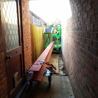 The Hooka accessing a very narrow alley the hooka can move heavy steel I-beams saving on crane hire. Hired from Hook-up Solutions call 07971 174 523 for Southern Hire or 01462 499 642 for Eastern Hire
