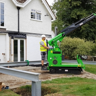 The Hooka carefully and easily placing a vertical steel I-beam into position on a site with tight side access. Hired from Hook-up Solutions call 07971 174 523 for Southern Hire or 01462 499 642 for Eastern Hire