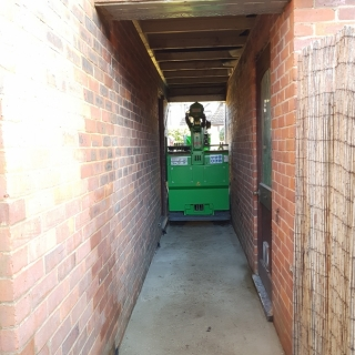 The Hooka installing a steel I-beam at the rear of a property with extremely tight access The Hooka is only one metre wide. Hired from Hook-up Solutions call 07971 174 523 for Southern Hire or 01462 499 642 for Eastern Hire