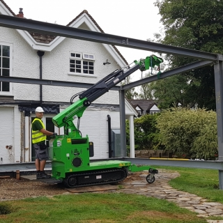 The Hooka installing steel I-beam with ease. Hired from Hook-up Solutions call 07971 174 523 for Southern Hire or 01462 499 642 for Eastern Hire