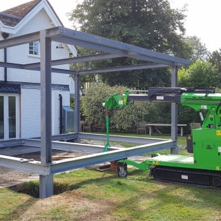 The Hooka installing steel I-beams for a large conservatory using a steel I-beam lifter. Hired from Hook-up Solutions call 07971 174 523 for Southern Hire or 01462 499 642 for Eastern Hire
