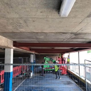 Hooka-installing-steel-beams-in-Gloucester-lift-and-carry-crawler-crane-restricted-access-multi-story-car-park