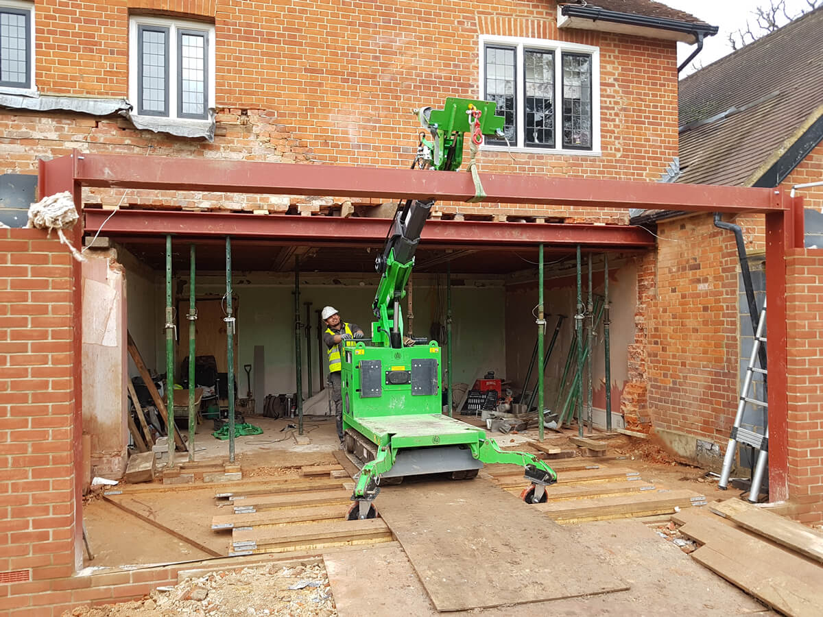 The Hooka on hire safely and easily installing 300kg cross steel i-beam at a height of 2600mm