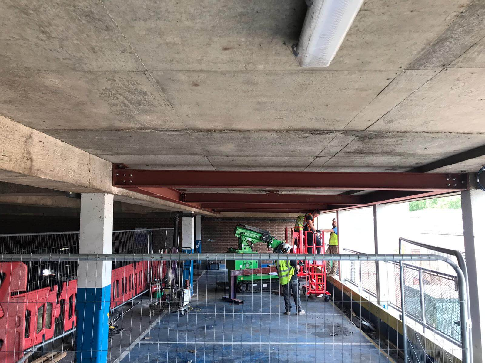 Hooka on hire installing steel I-beams in Gloucester, lift and carry crawler crane restricted access multi-story car park