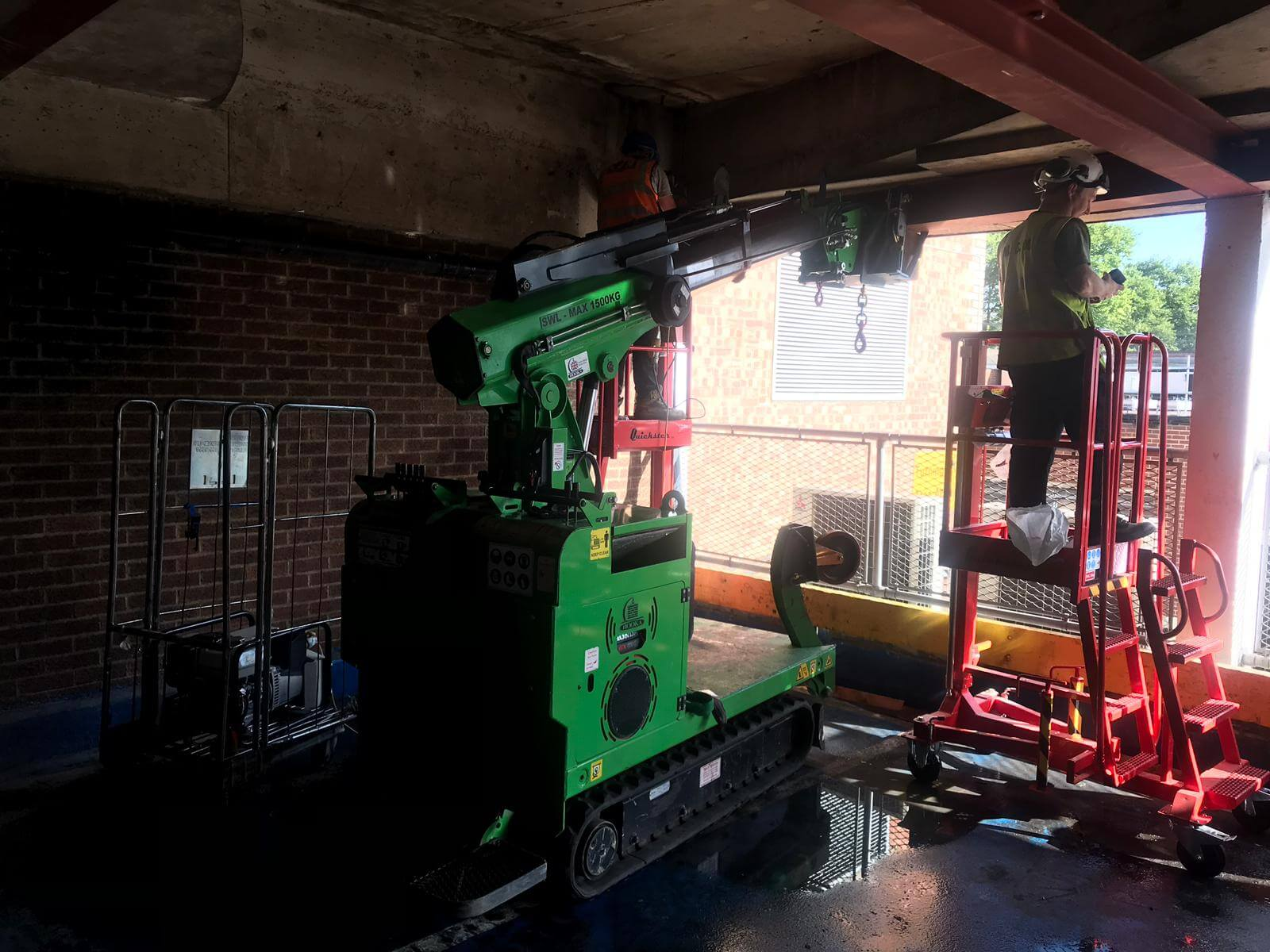 Hooka on hire installing steel I-beams in Gloucester, lift and carry crawler crane tracked forklift